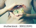 Woman's Hands Holding Little...