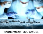 surgical tools lying on table... | Shutterstock . vector #300126011