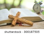 Open Holy Bible And Wooden...