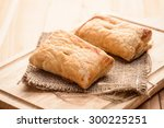 pies of puff pastry close up on ... | Shutterstock . vector #300225251