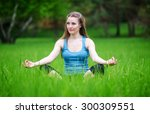 young girl practicing yoga in... | Shutterstock . vector #300309551