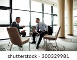 coworkers discussing project in ... | Shutterstock . vector #300329981