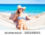 pretty woman relaxing in the... | Shutterstock . vector #300348041