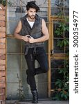 handsome man model dressed punk ... | Shutterstock . vector #300354977