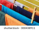 Drying Colorful Clothes Hanged...