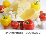 Various sorts of cheeses, fresh vegetables and mushrooms - stock photo