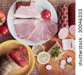 Sliced meat, salmon, sausages, lemon, tomato  and garden radish - stock photo