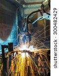 robots welding in a car factory | Shutterstock . vector #300482429