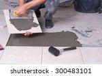 Tiler Installing Ceramic Tiles...
