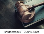 Gavel And Legal Book On Wooden...