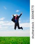 lucky businessman in jump against blue sky - stock photo