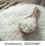 white rice in the wooden spoon... | Shutterstock . vector #300555887