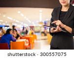 woman using tablet in shopping... | Shutterstock . vector #300557075