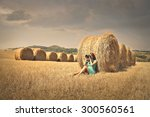 Young Woman Sitting In A Grain...