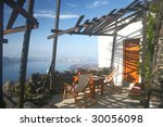 view deck on santorini cliff, Greece - stock photo