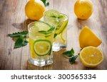 lemon water with fresh lemons... | Shutterstock . vector #300565334