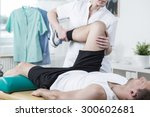 female physiotherapist training ... | Shutterstock . vector #300602681