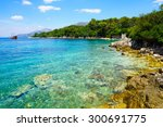 A Rocky Shore  Boats And A Shi...