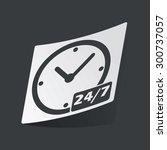 white sticker with black clock...