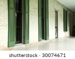 An Old Porch With Windows At...
