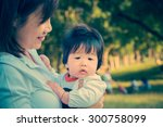 baby with young mother outdoor  ... | Shutterstock . vector #300758099