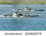 Small photo of Rovno, Ukraine - 17 September 2007. AFV BMP-2 crossing the river on maneuvers.