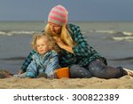 mother and daughter sitting at... | Shutterstock . vector #300822389