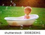 Little Girl Bathes In A Bath...