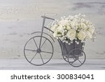 Stock photo white roses in a bicycle vase 300834041