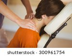 young woman getting massage in... | Shutterstock . vector #300961754