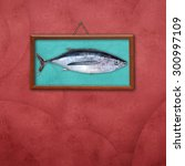 Small photo of Albacore, picture hanging on a wall with space for text
