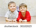 funny boy and a girl lying on... | Shutterstock . vector #30102025