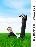 carefree woman resting at the green grass - stock photo