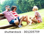 three friends sitting on a... | Shutterstock . vector #301205759