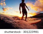 surfing at sunset. young man... | Shutterstock . vector #301223981