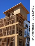 Condo construction with wood frames - stock photo