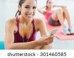 young smiling woman at the gym... | Shutterstock . vector #301460585