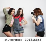 a girl takes picture of her... | Shutterstock . vector #301516865