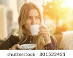 beautiful blonde female drink... | Shutterstock . vector #301522421