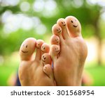 smiley faces on a pair of feet ... | Shutterstock . vector #301568954