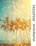 Palm Trees On Tropical Beach...