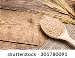 wheat bran in wooden spoon with ... | Shutterstock . vector #301780091