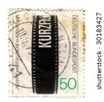 Old canceled german stamp with film - stock photo