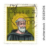 Old canceled german stamp with Benedict of Nursia - stock photo