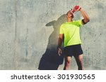 young tired athlete refreshing... | Shutterstock . vector #301930565