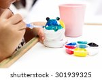 The Kid Painting Color On The...