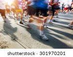 marathon runners in motion.... | Shutterstock . vector #301970201