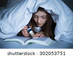 Girl Reading Book With...