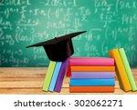 graduation  mortar board  book. | Shutterstock . vector #302062271