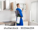 young worker spraying... | Shutterstock . vector #302066204